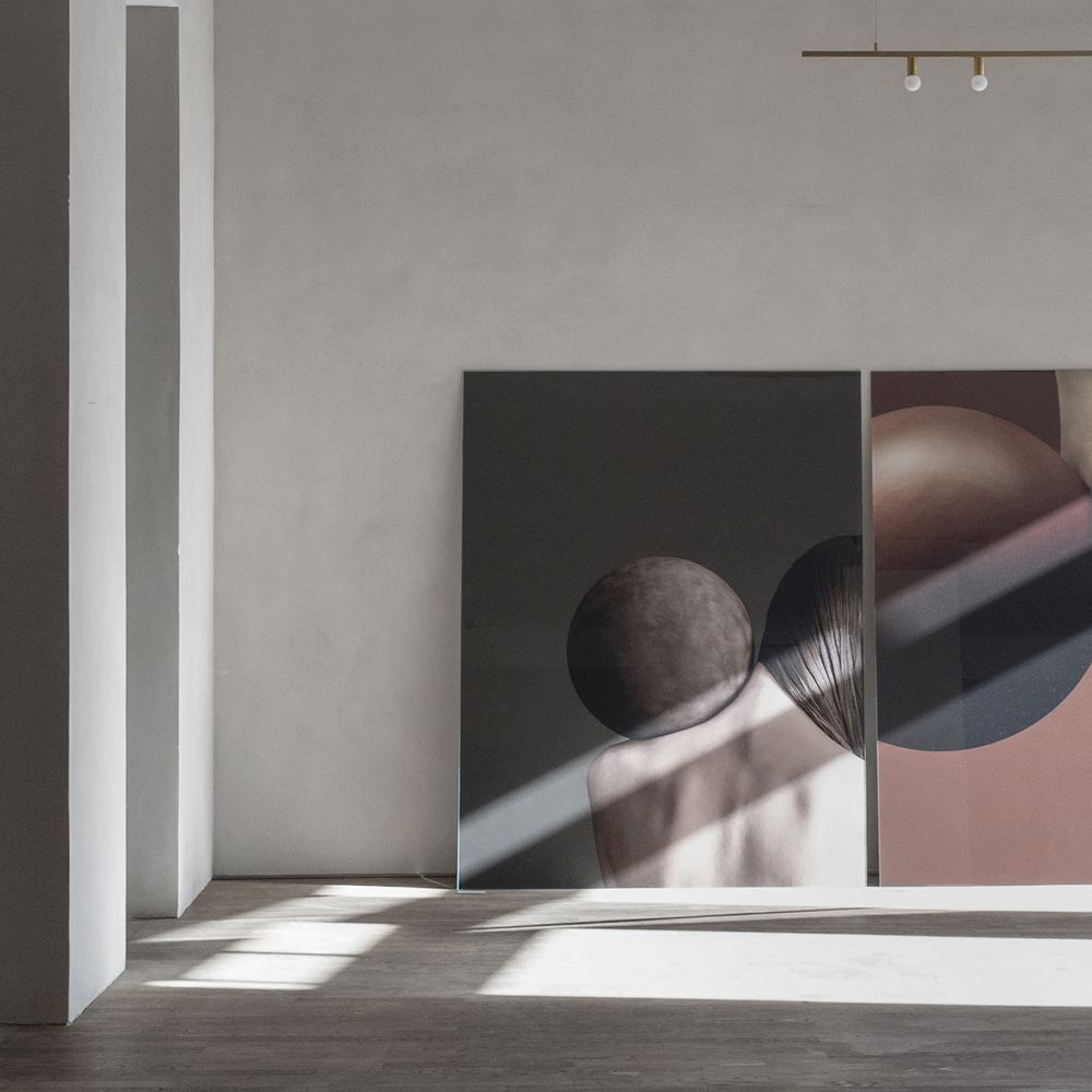 The Kinfolk Gallery featuring large images with models and brown leather balls
