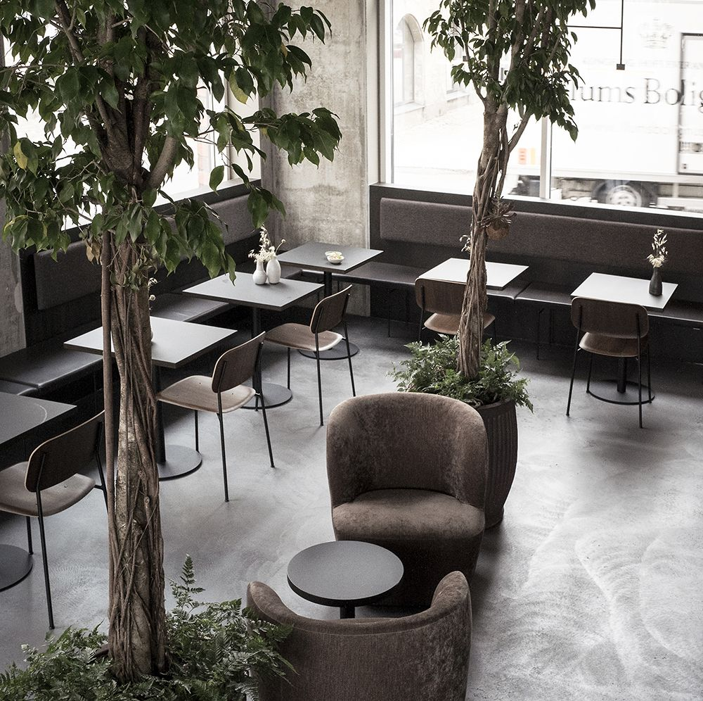 Industrial restaurant with bench seating in Black leather