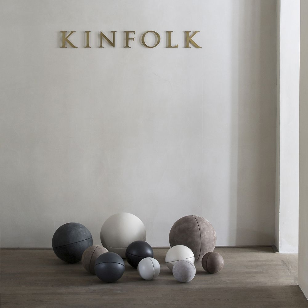 The Kinfolk Gallery with leather balls in different sizes on the floor