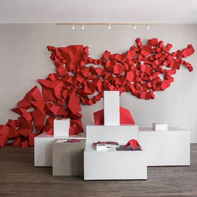 The Kinfolk Gallery in Copenhagen featuring a red art installation on the wall.