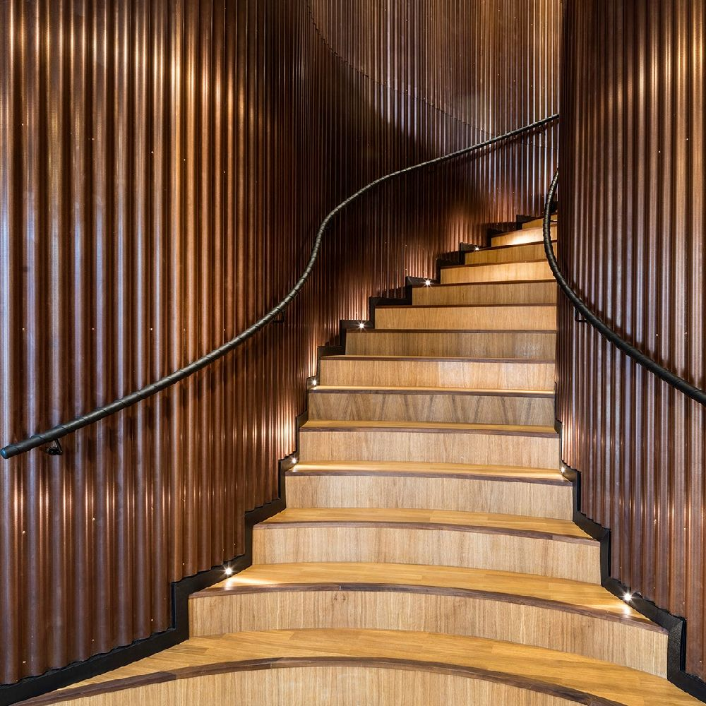 Wooden staircase inside Axel Towers
