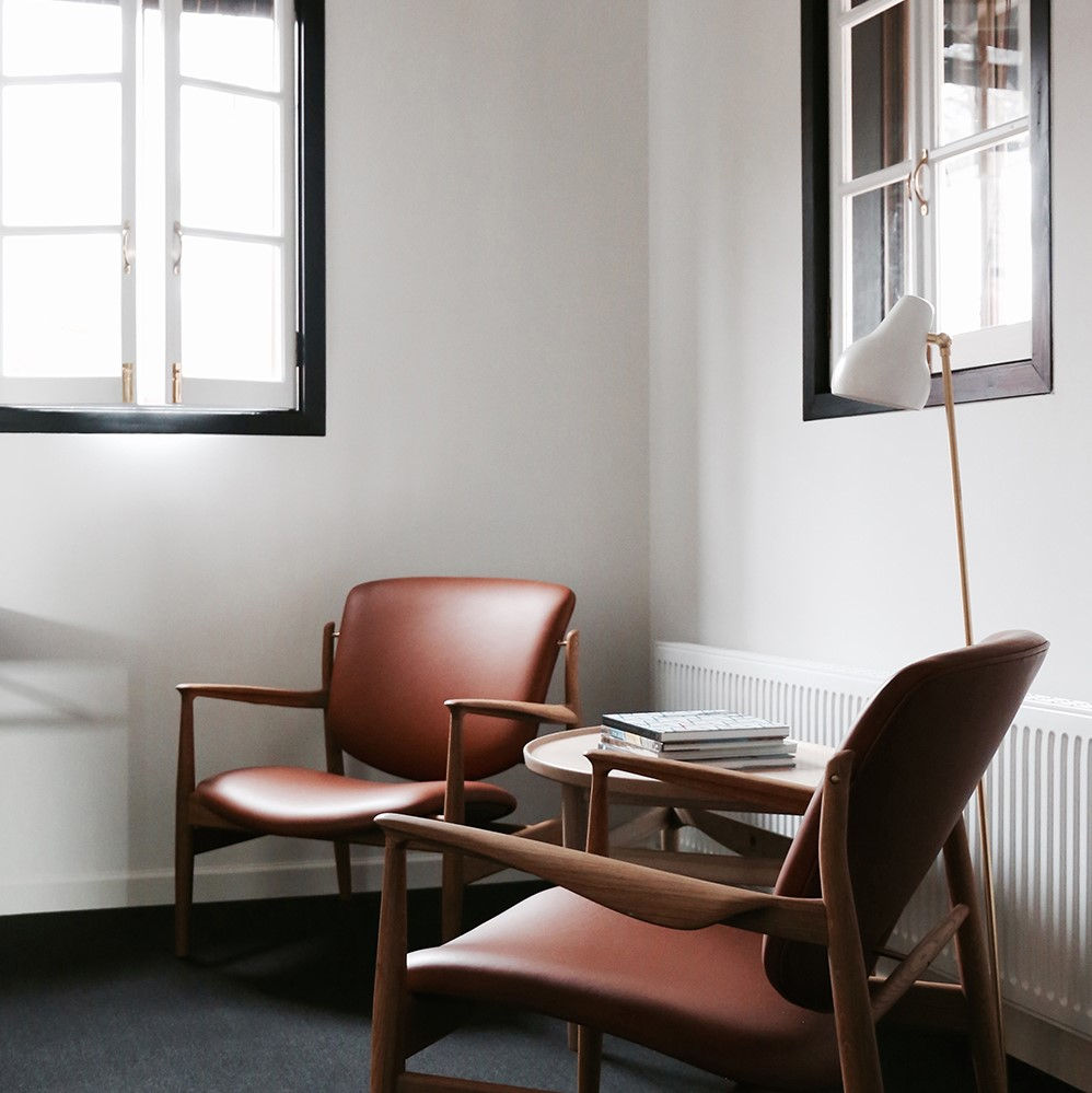 Two Hakuba France Chair by Finn Juhl crafted with brown Sørensen Leather