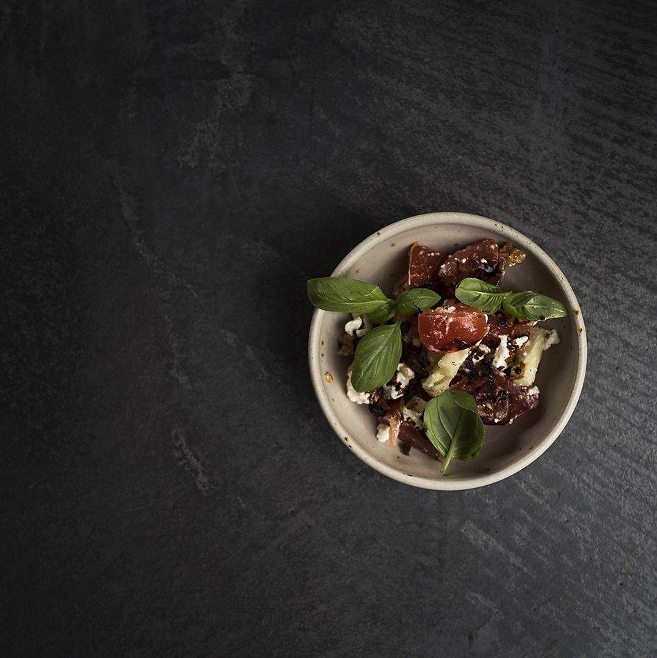 Cheramic bowl with basil and tomato salat