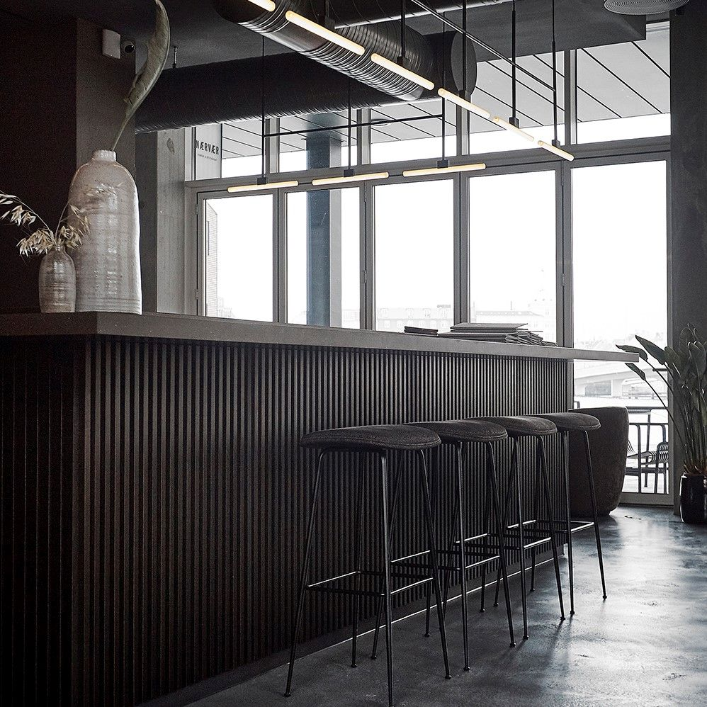 Restaurant bar with bar stools in black leather