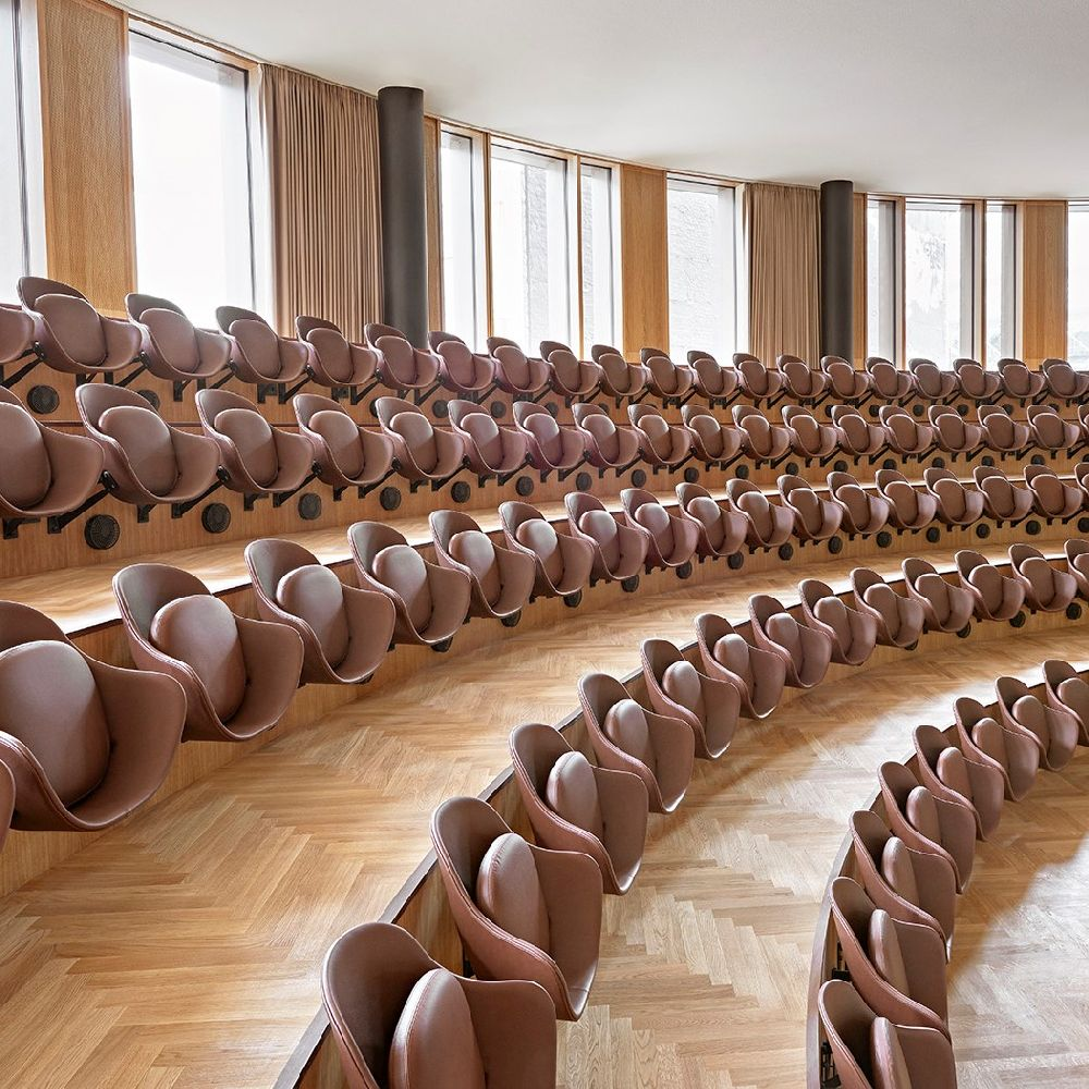 Auditorium inside Axel Towers with seats by Engelbrechts crafted in brown Sørensen Leather.