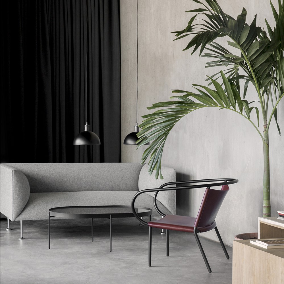 Grey fabric sofa and Lounge Chair crafted with red Sørensen Leather