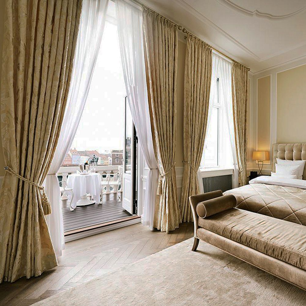 D'Angleterre Hotel Copenhagen bedroom suite with golden curtains