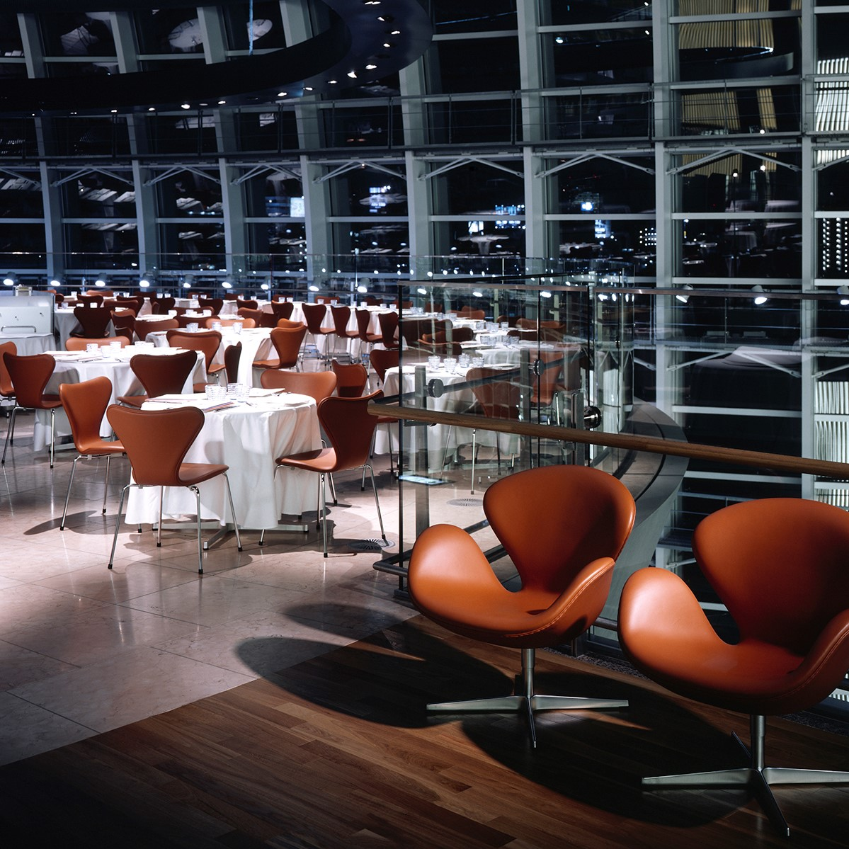 Tower restaurant inside the National Art Center in Tokyo set up with eries 7™ chairs and Swan™ chairs by Arne Jacobsen