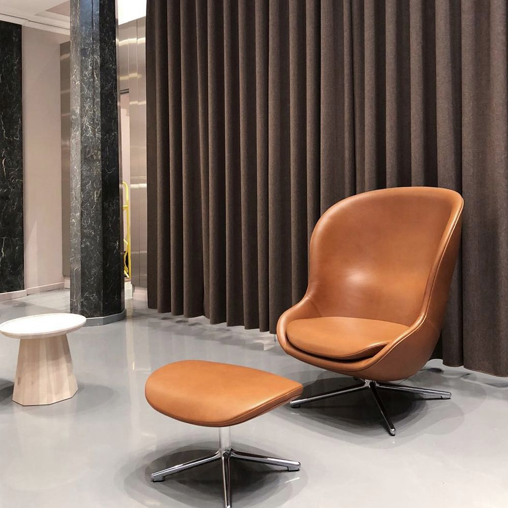 Cognac leather lounge chair with a footstool