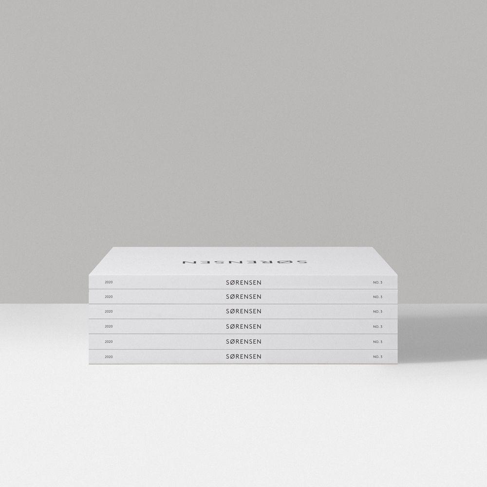 Stack of white Sørensen Leather brand books