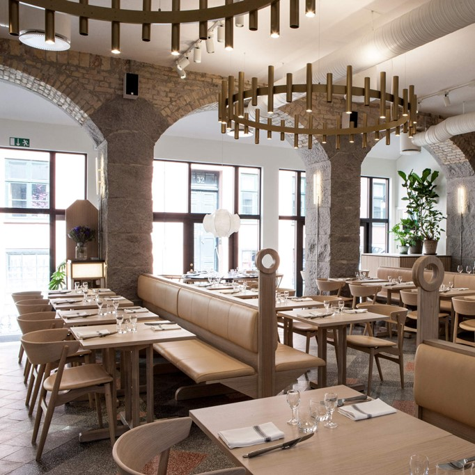 Aamanns 1921 restaurant with wooden tables and seating crafted with Sørensen Leather.