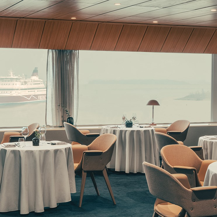 Inside Palace Restaurant in Helsinki with sea view and chair in Sørensen Leather SPECTRUM Camel