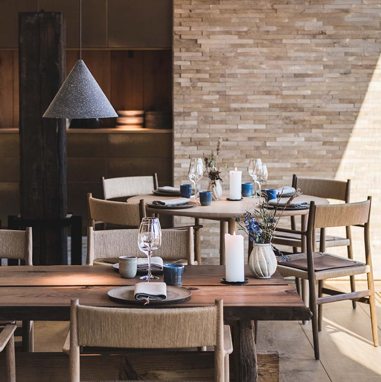 Restaurant setting with oak chairs and cushions crafted Sørensen Leather Dunes