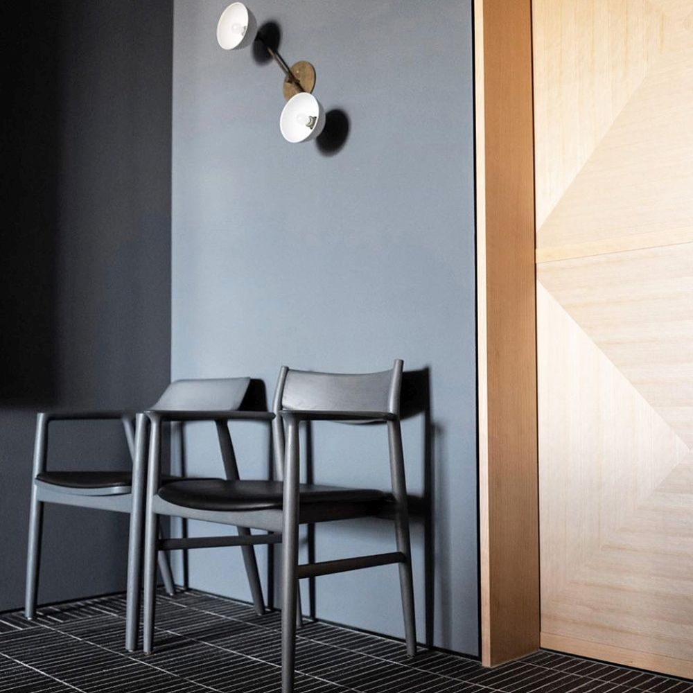 Two JARI chairs crafted with black Sørensen Leather.