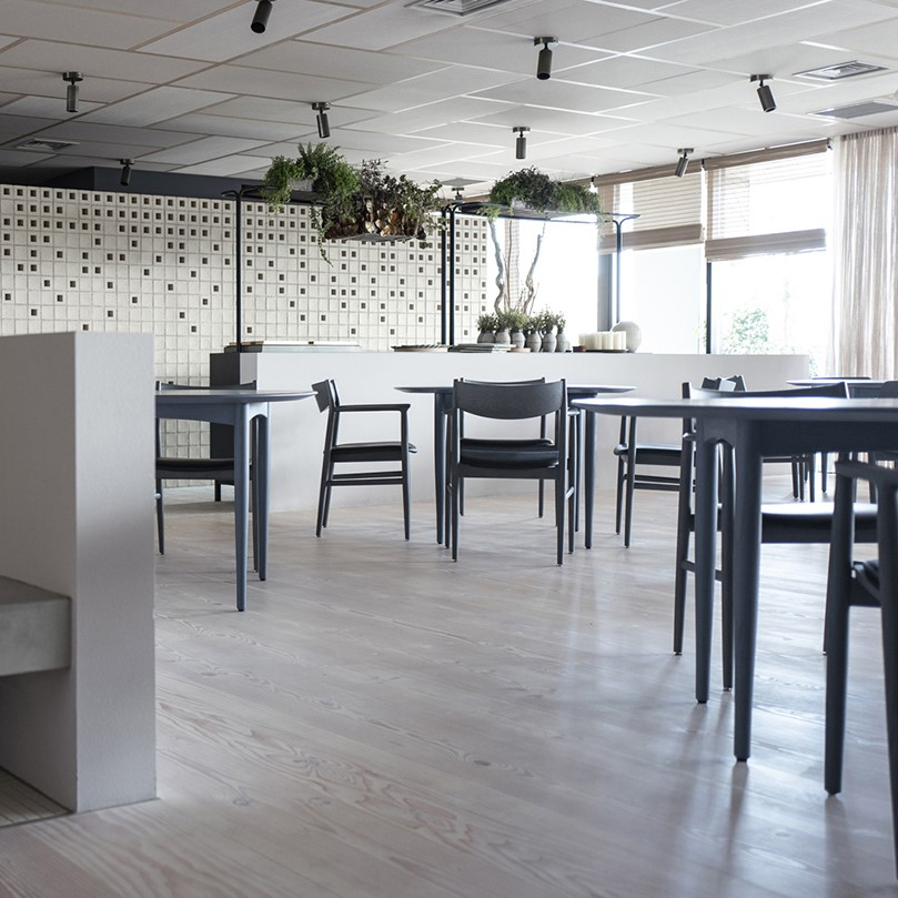 Inside INUA in Tokyo featuring JARI chairs with black Sørensen Leather.
