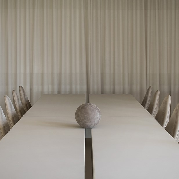 Sørensen Leather conference room with beige curtains and a light grey conference table and chairs in leather