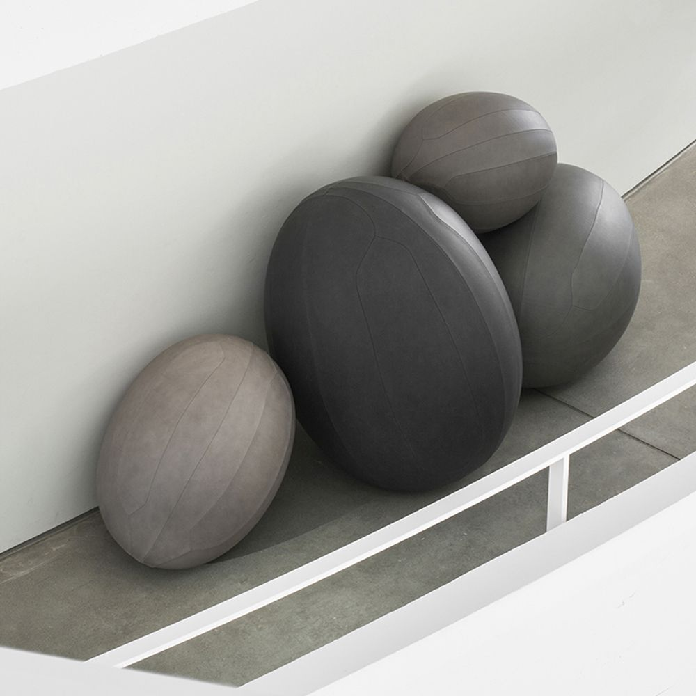 Oval balls in light and dark grey leather co-created with Space Copenhagen