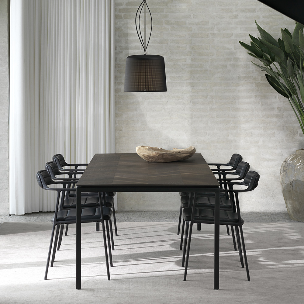 Dinning room chairs crafted in black leather around dark wooden dinning table