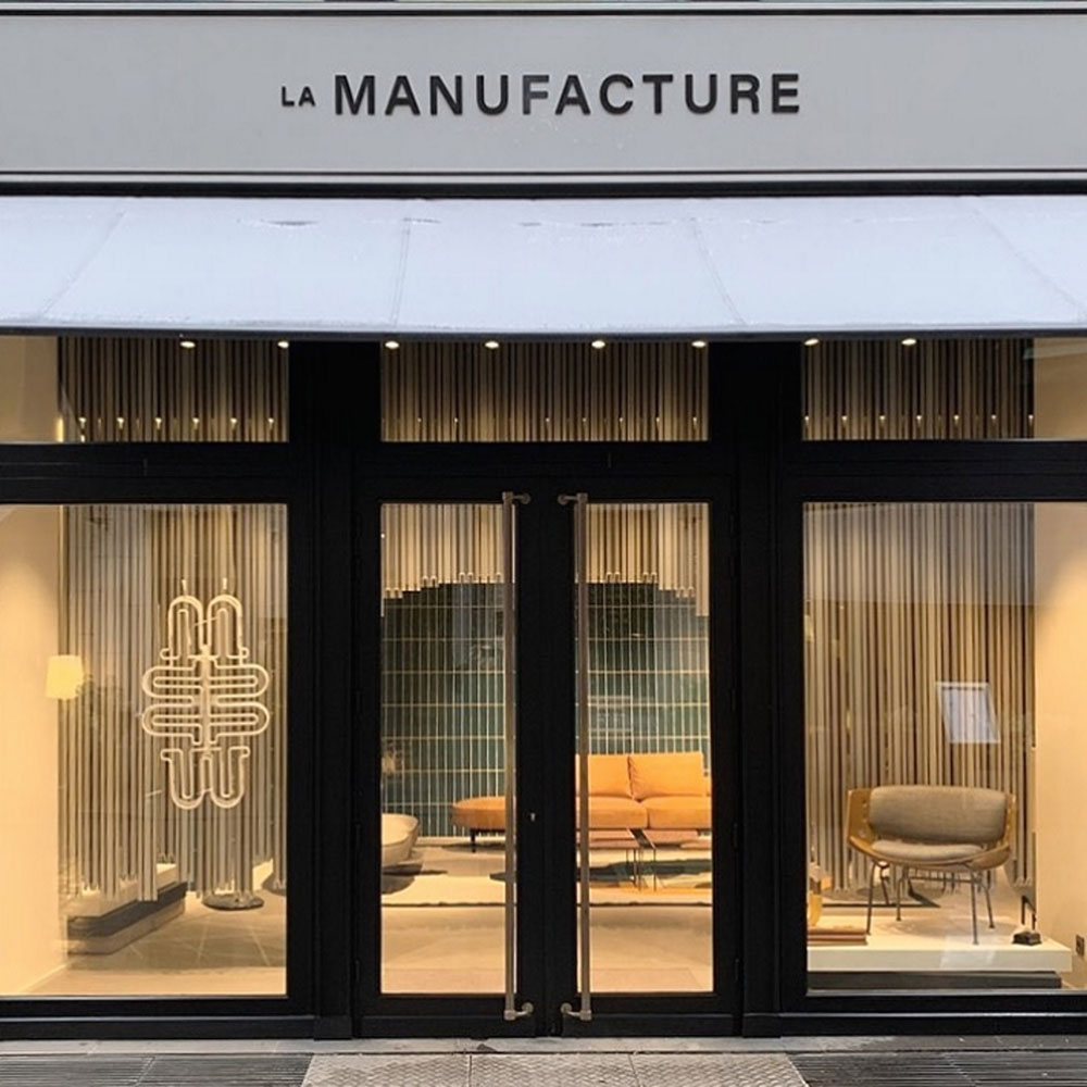 The outside of a Paris boutique with glass windows