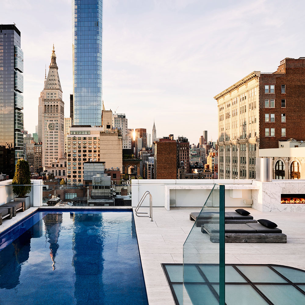 Rooftop pool in New York with black leather sunbeds