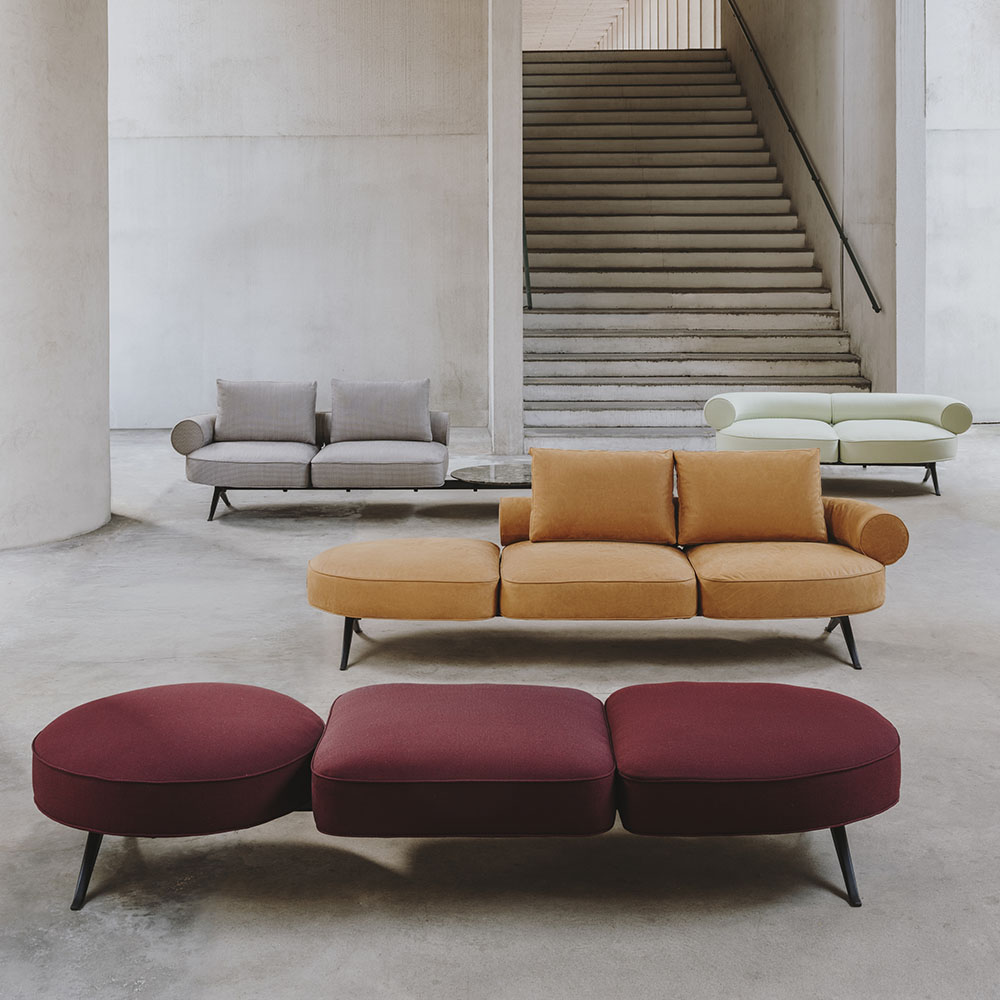 Inside Paris boutique with three sofas in red, orange and grey