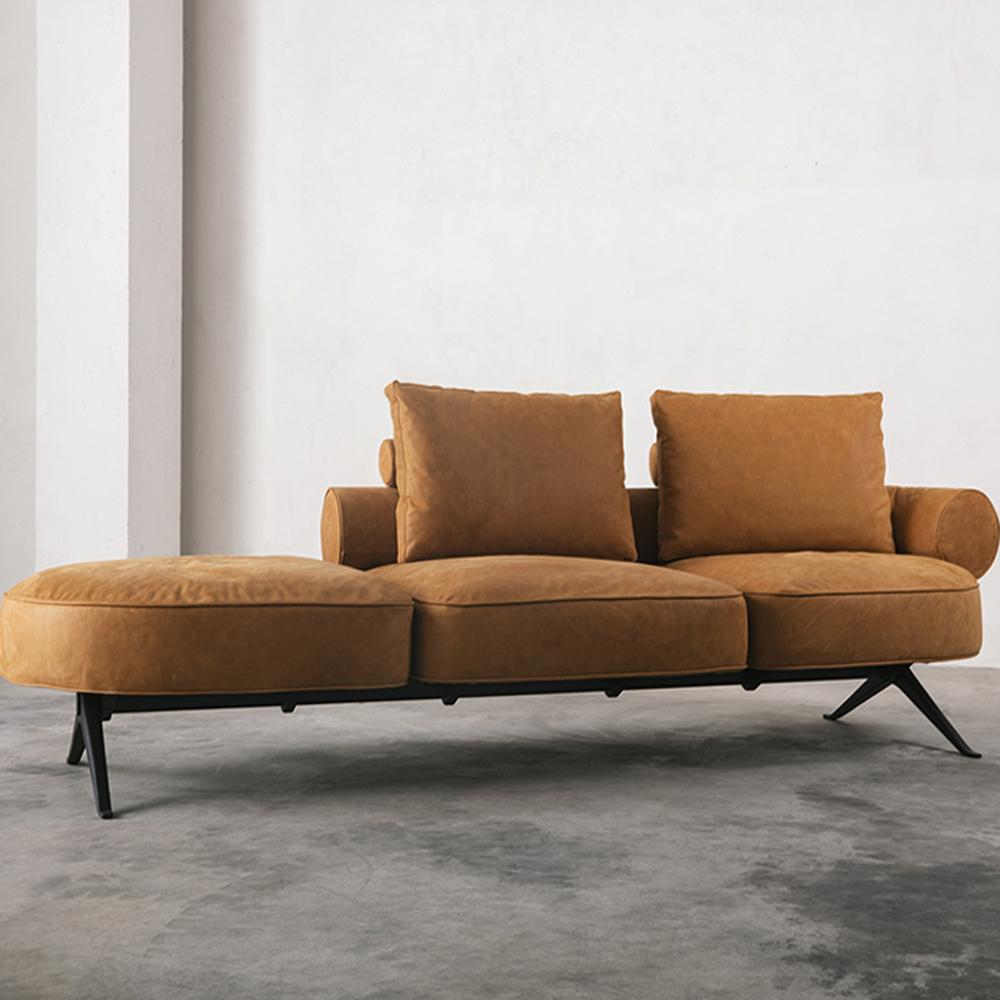 Orange leather sofa for three people