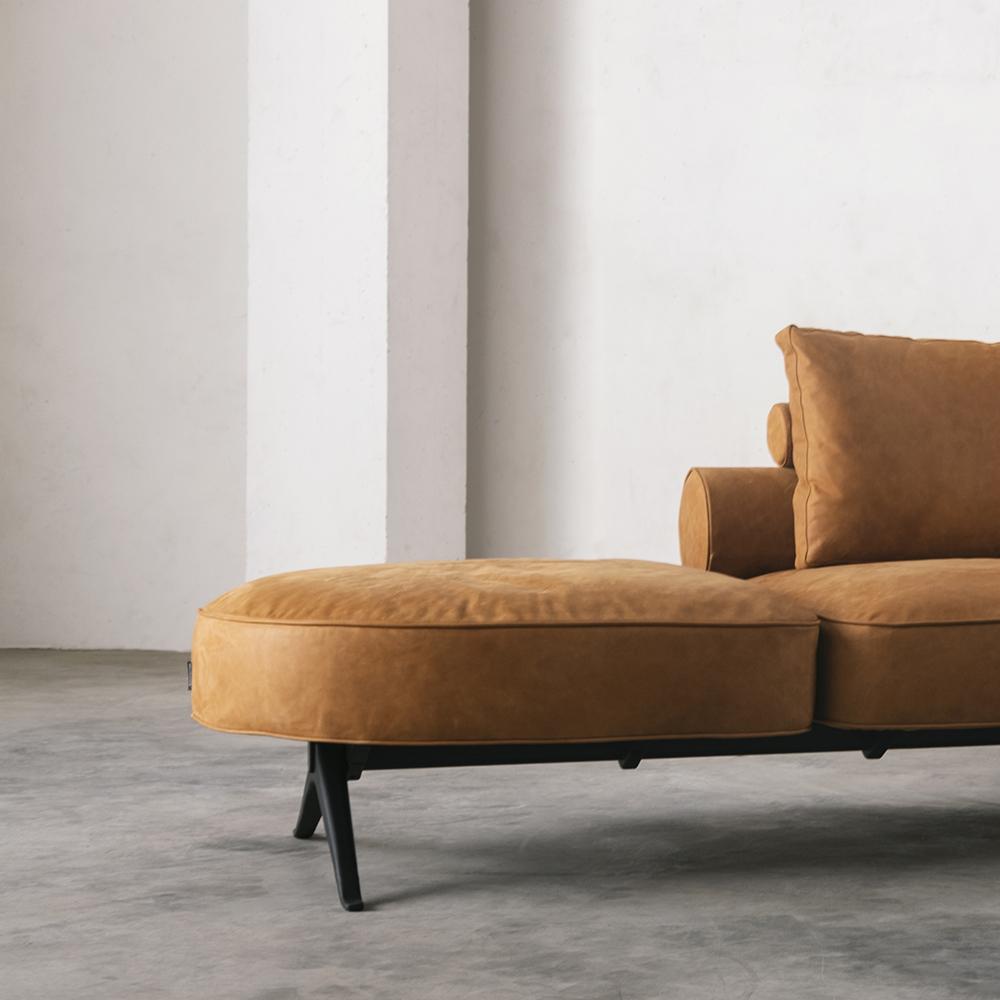 Left side of orange leather sofa