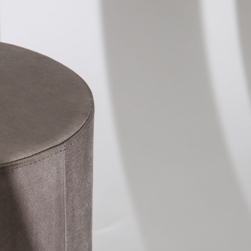 Close-up of pillar upholstered in leather