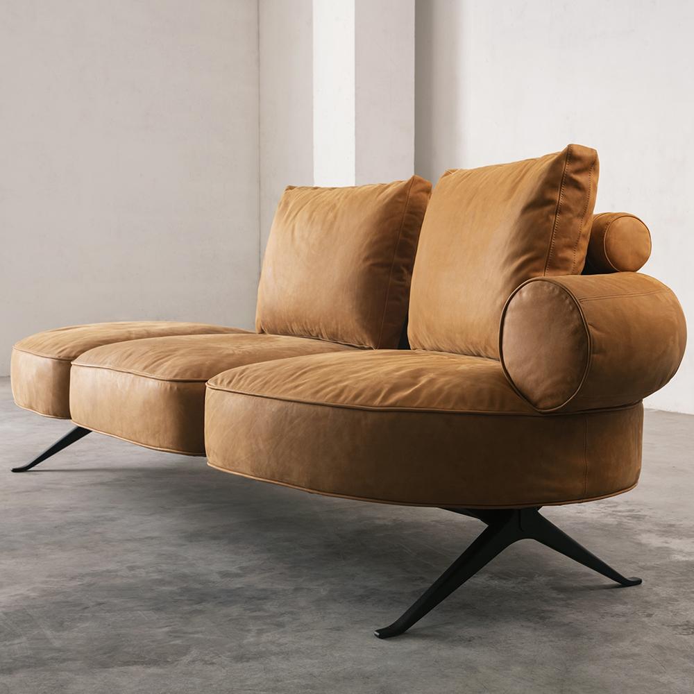 Orange leather sofa in grey concrete room