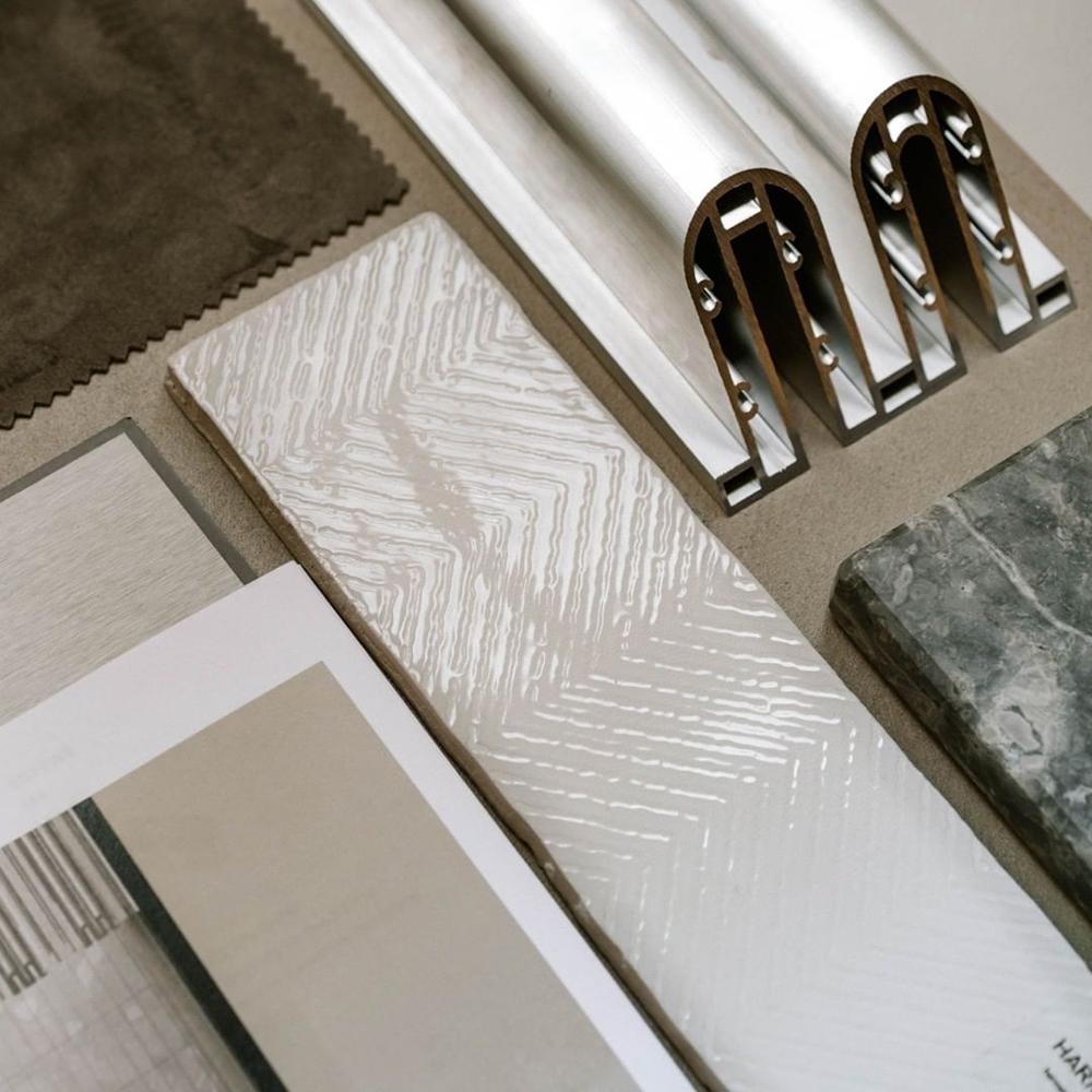 Different materials in marble and aluminium