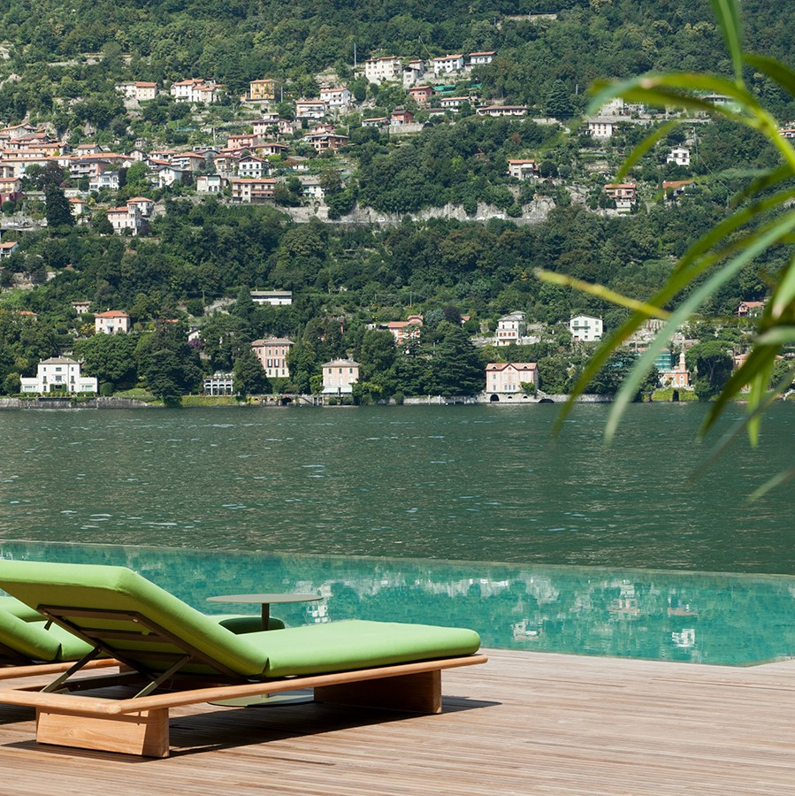 Ocean view from wooden sunbed with green leather cushions at Italy's Il Sereno Lago di Como Hotel