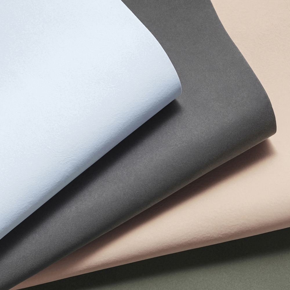 Our FLUX® collection showing Light Blue, Anthrazite, Light Brown and Dark Green